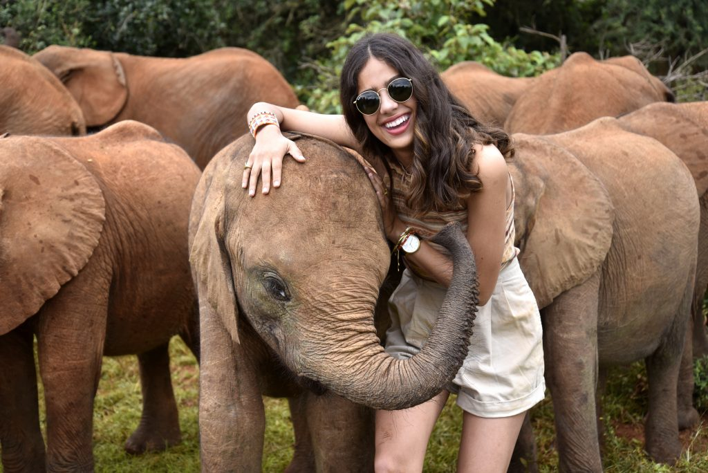 Sasha Pinto and an elephant at the David Sheldrick Wildlife Trust