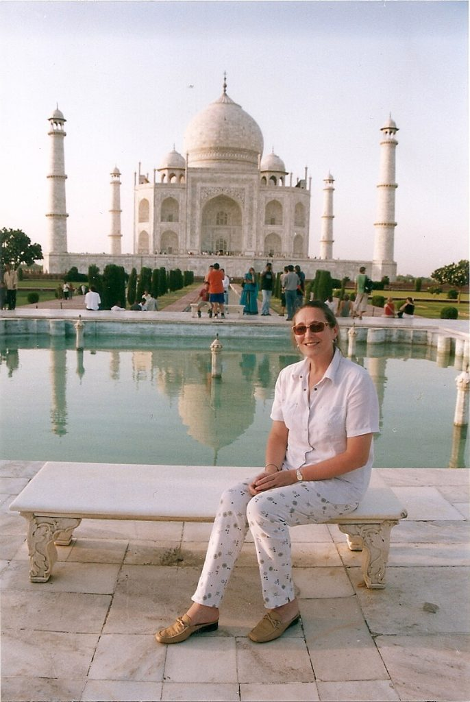 Marion Miller sits on a bench in front of the Taj Mahal