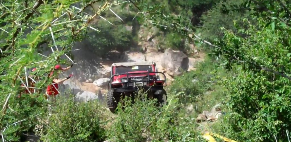 Rhino Charge car driving up a hill