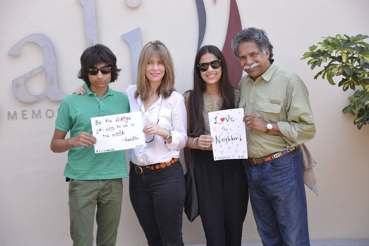 Pinto family pose with signs