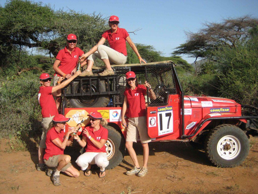 Rhino Charge team posing next to a car