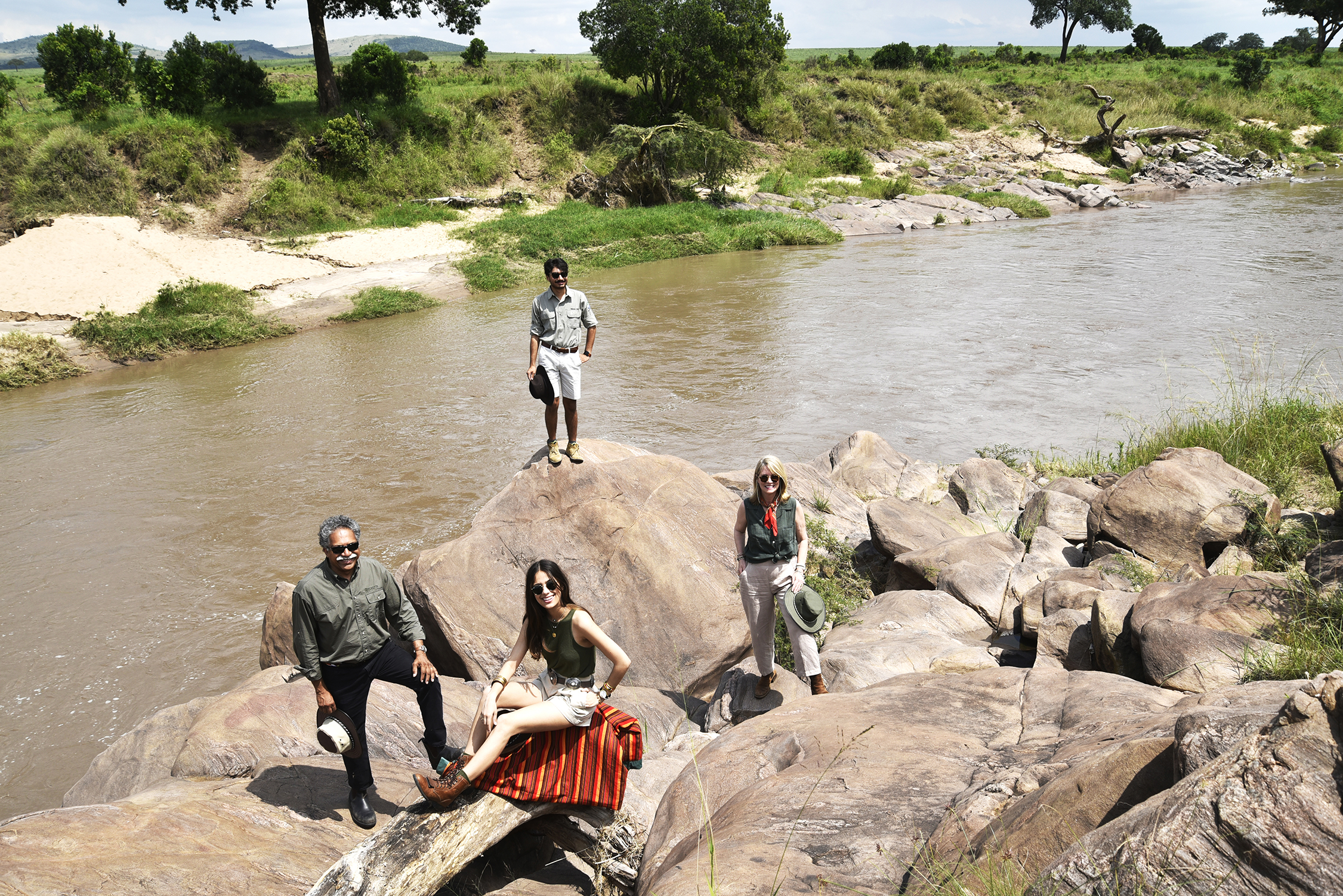 The Pintos standing by a river