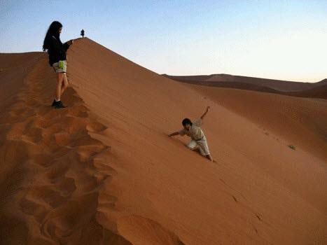 Kids play on sand dunes