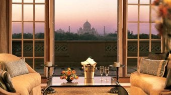 Wine on the table with the Taj Mahal in the background