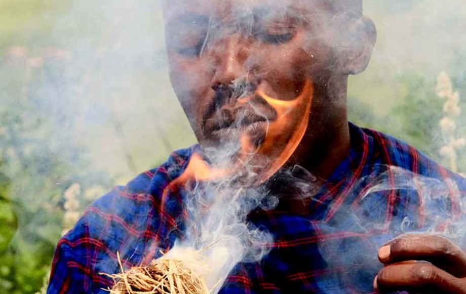 A man making fire