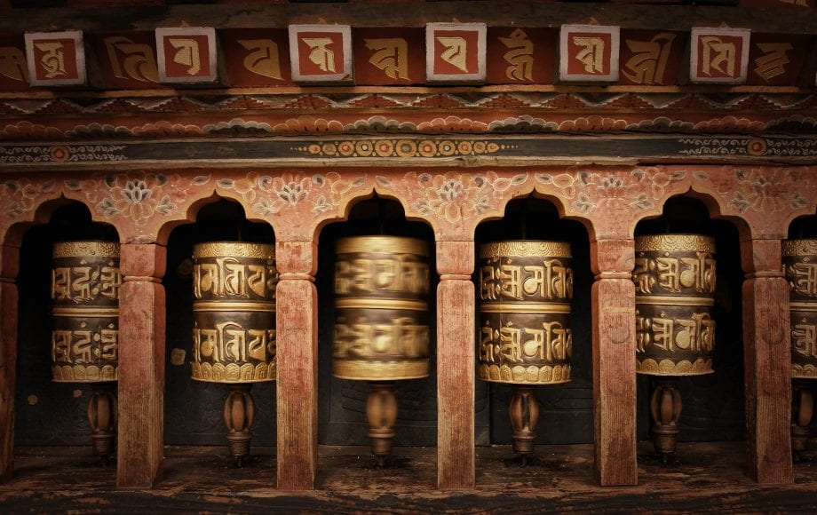 Bhutan copper prayer wheel in traditional monastery