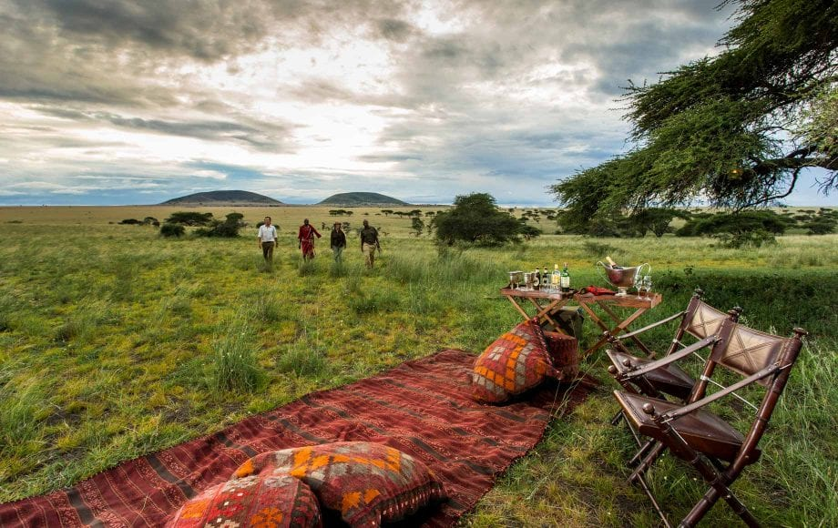 Tourists walking back to picnic from nature stroll at Chyulu Hills in Africa