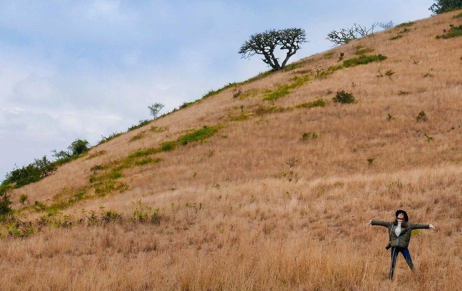 Woman enjoying freedom and fresh air at Chyulu Hills African Safari