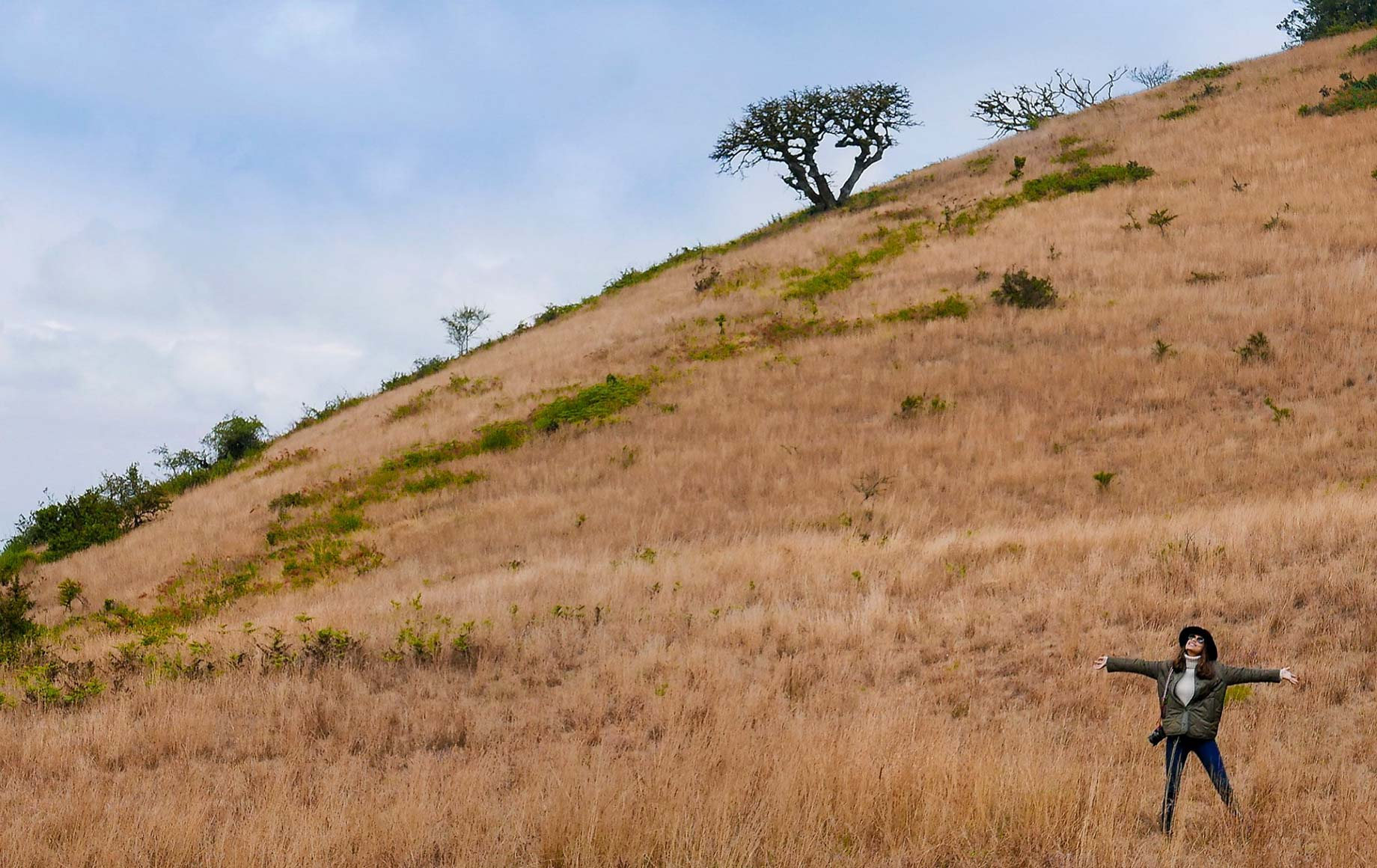 Woman enjoying freedom and fresh air at Chyulu Hills African Safari