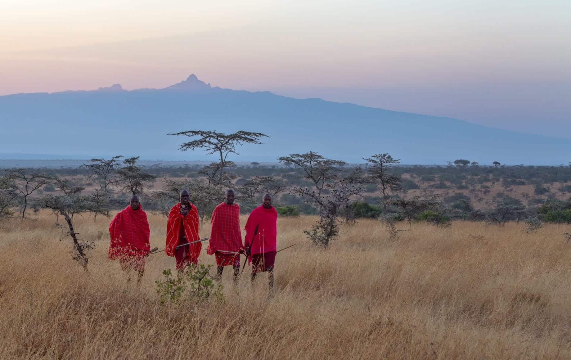 Men strolling at Laikipia Plateau African Safari