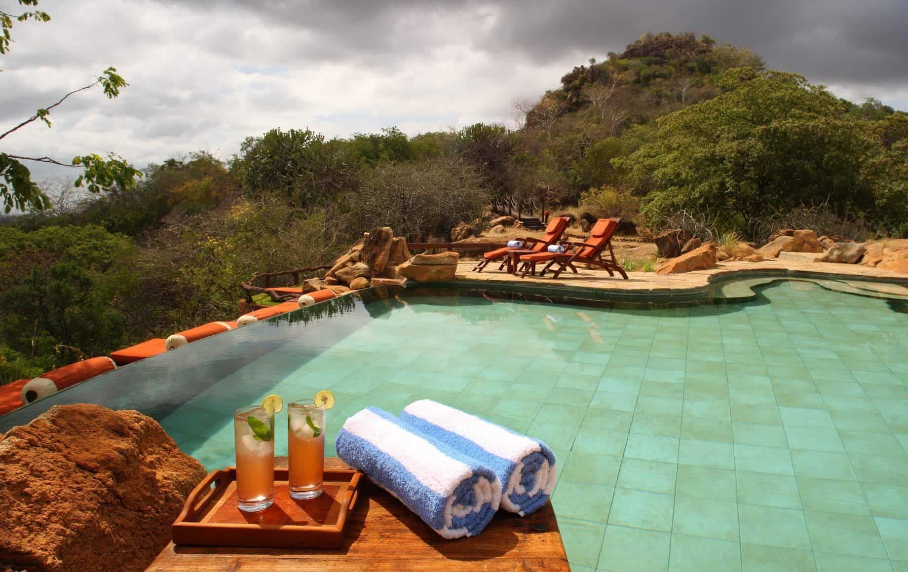 Enjoying champagne while watching sunset at Meru National Park, Kenya