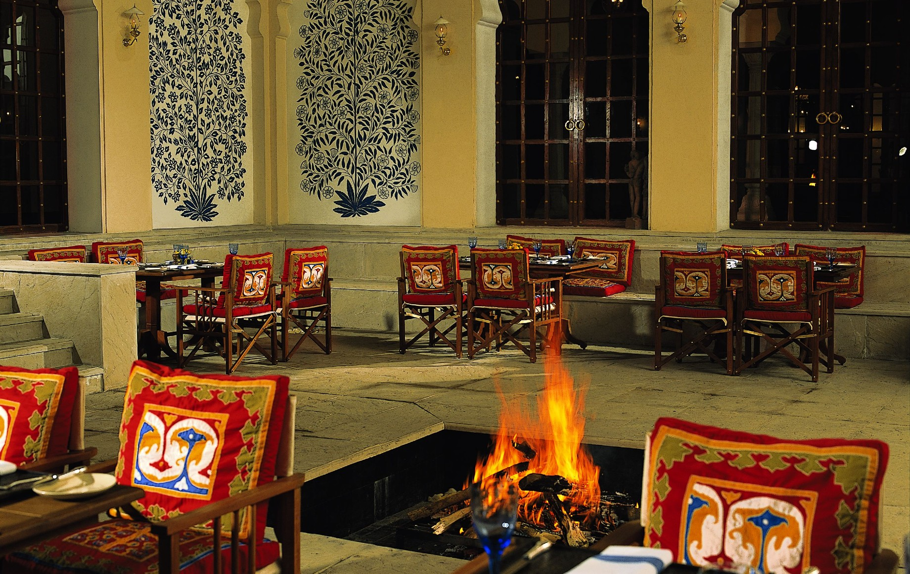 a dining room with a fire pit