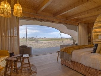 A bedroom looking out into the safari
