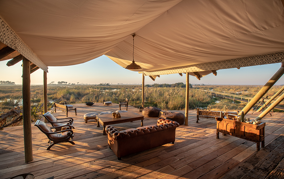 An outdoor seating area overlooking an open field