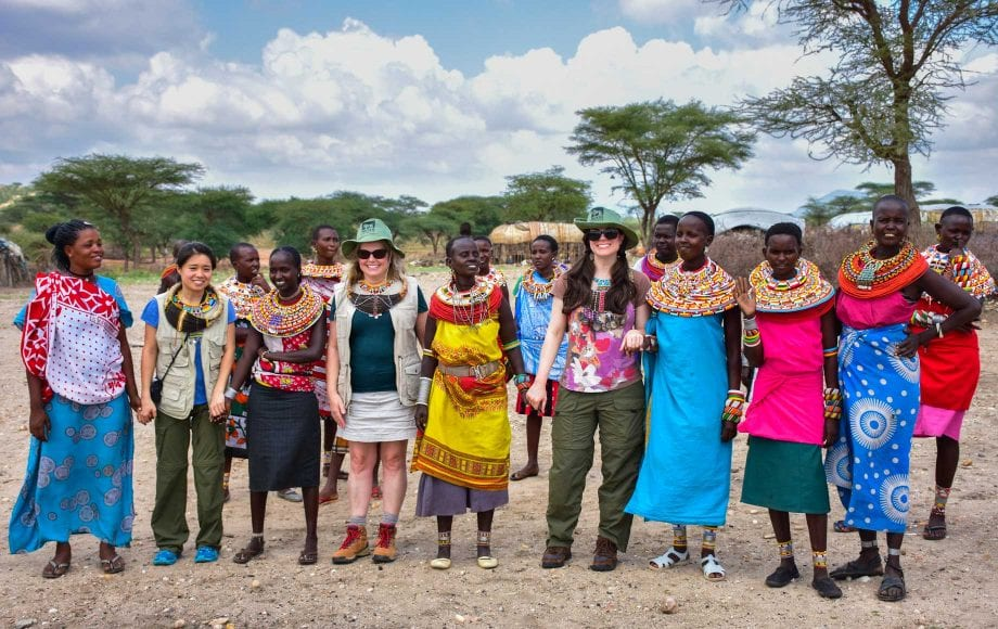 Smiling tourists and tribe ladies at Samburu National Reserve