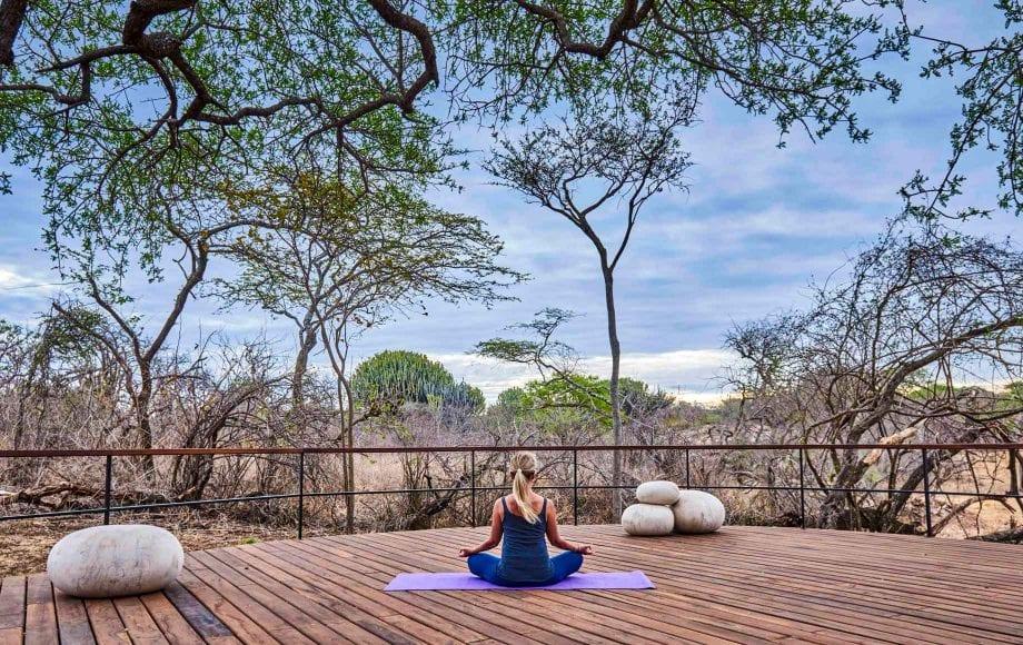 Yoga on lodge decks, Serengeti safari, Tanzania