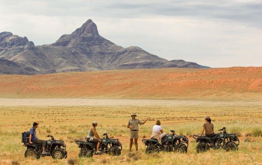 Tourists traveling across Sossusvlei Namib Desert