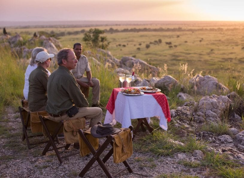 Family picnic dinner in nature at Tarangire African Safari