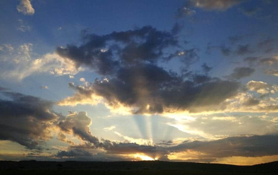Bright sun shining through the clouds at Tarangire African Safari