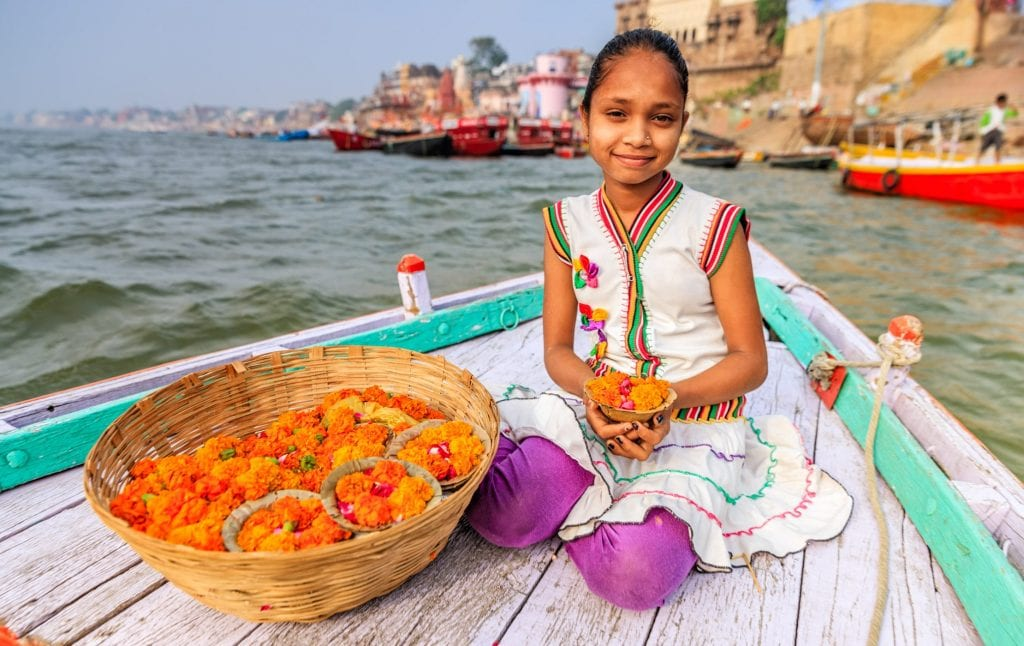 Girl sitting on boat in the Ganges River