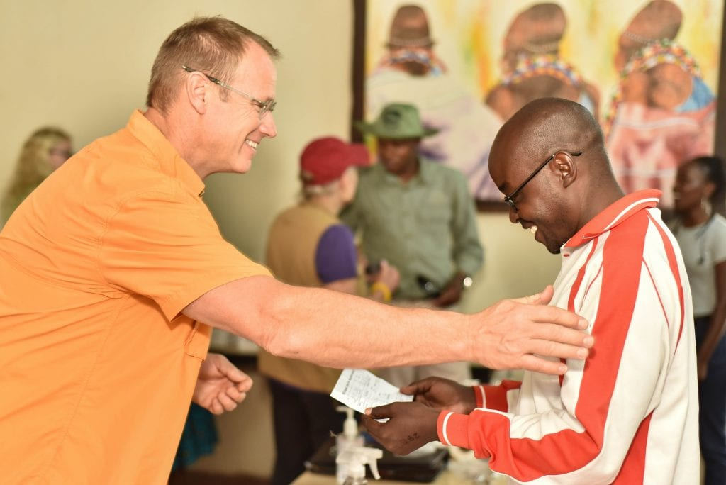 A patient is given his new glasses