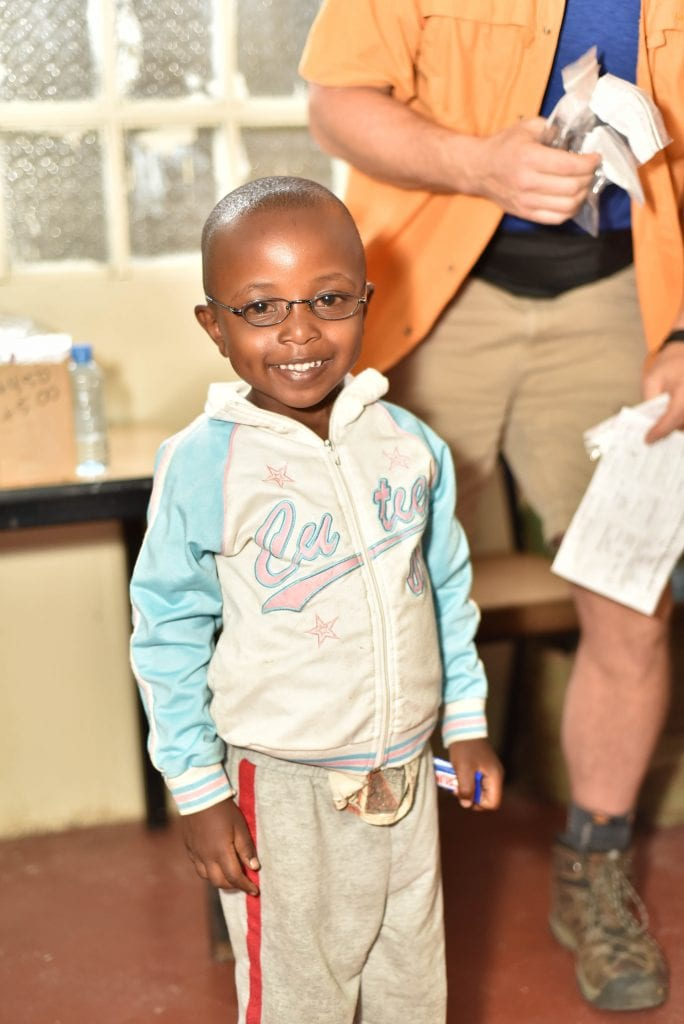 A child wearing their new glasses
