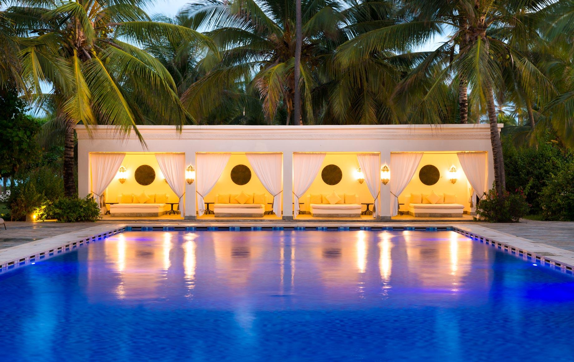Outdoor pool of Baraza Resort & Spa at dusk