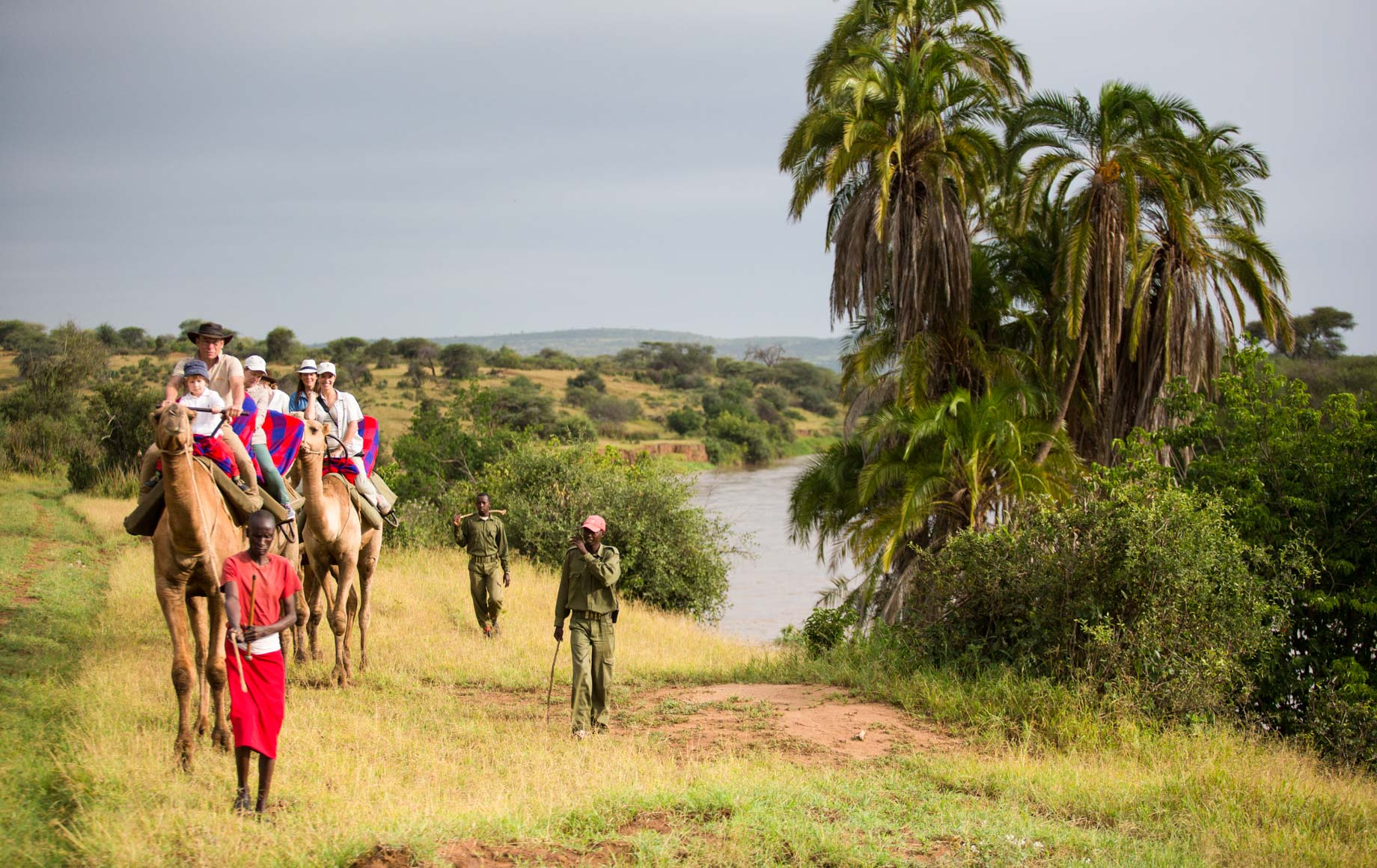 Guides and locals on horseback in Loisaba Conservancy