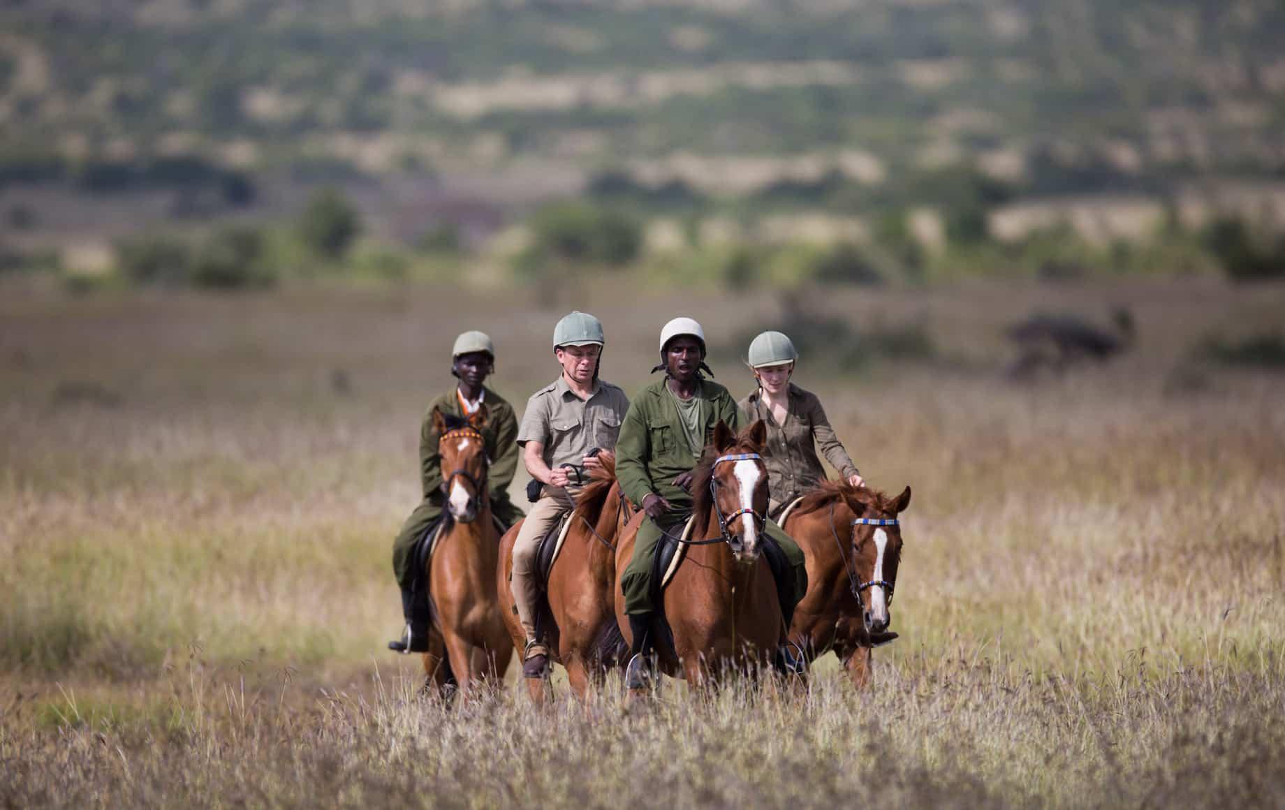 Safari guides on horseback at Loisaba Conservancy