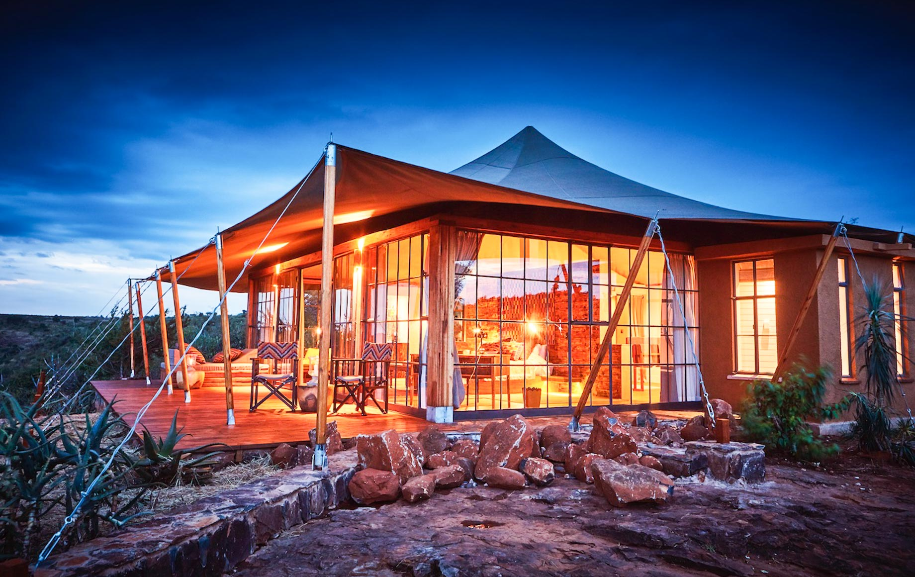 Exterior of suite at Loisaba Lodo Springs at night