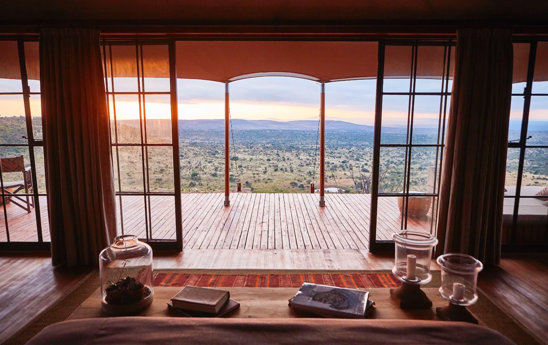 View through deck doors of suite at Loisaba Lodo Springs