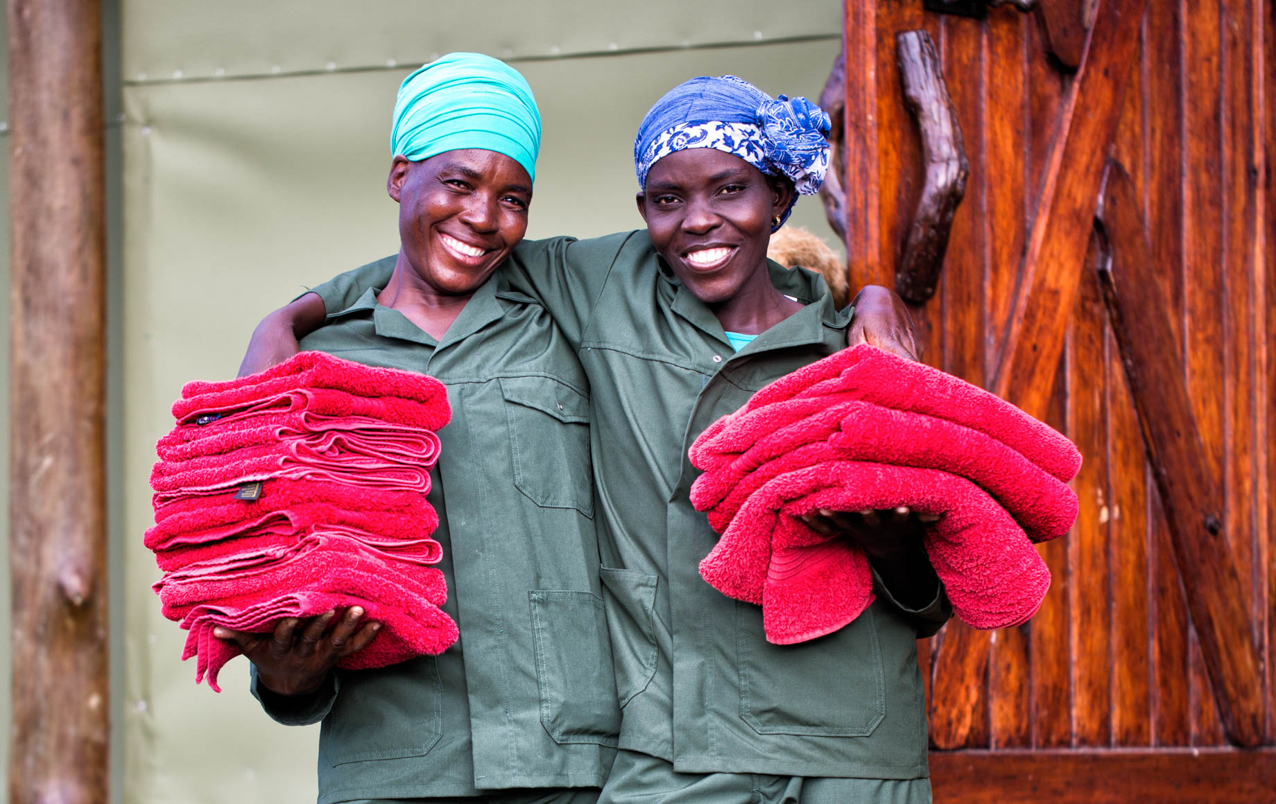 Mapula Lodge staff hold stacks of red towels