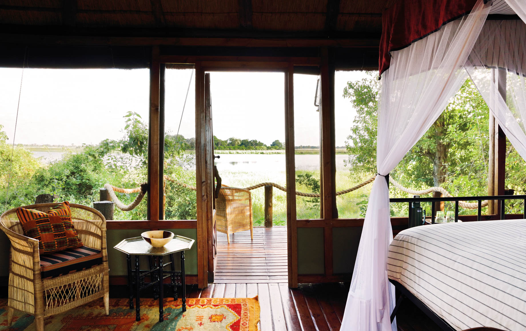 View through deck windows of Mapula Lodge room