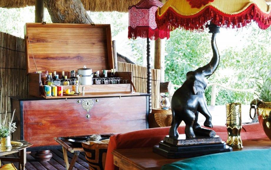 Open liquor cabinet in Mapula Lodge room