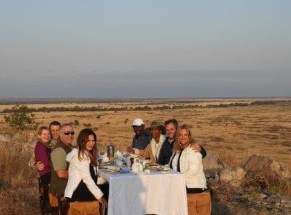 Friends eating dinner in the desert