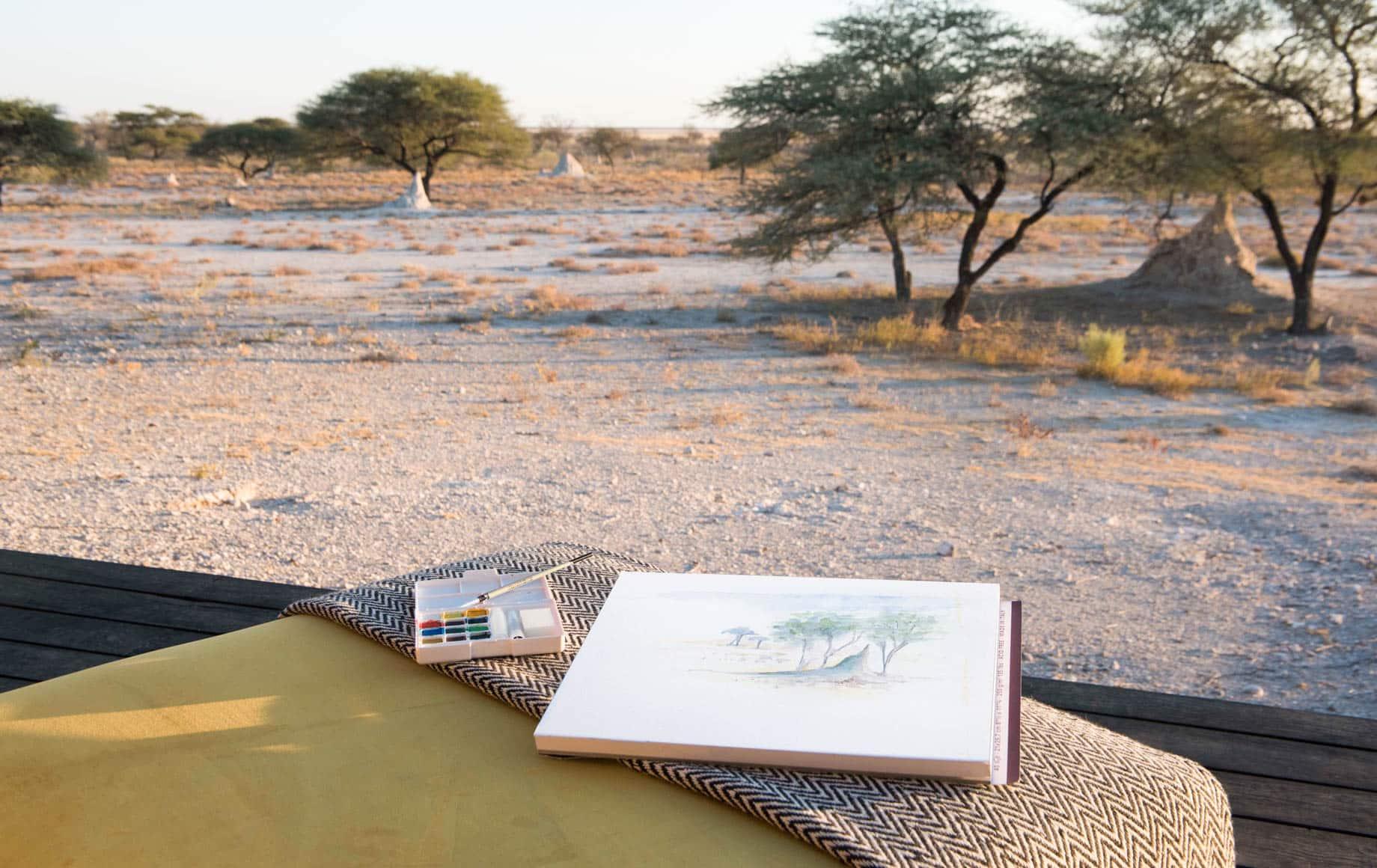 Sketchbook on chair near Africa plains