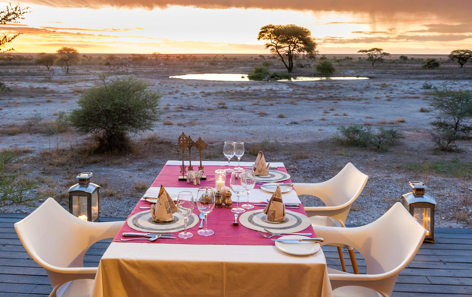Table set for four overlooks Africa plains