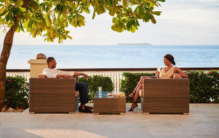 Couple has drinks on deck at Park Hyatt, Zanzibar