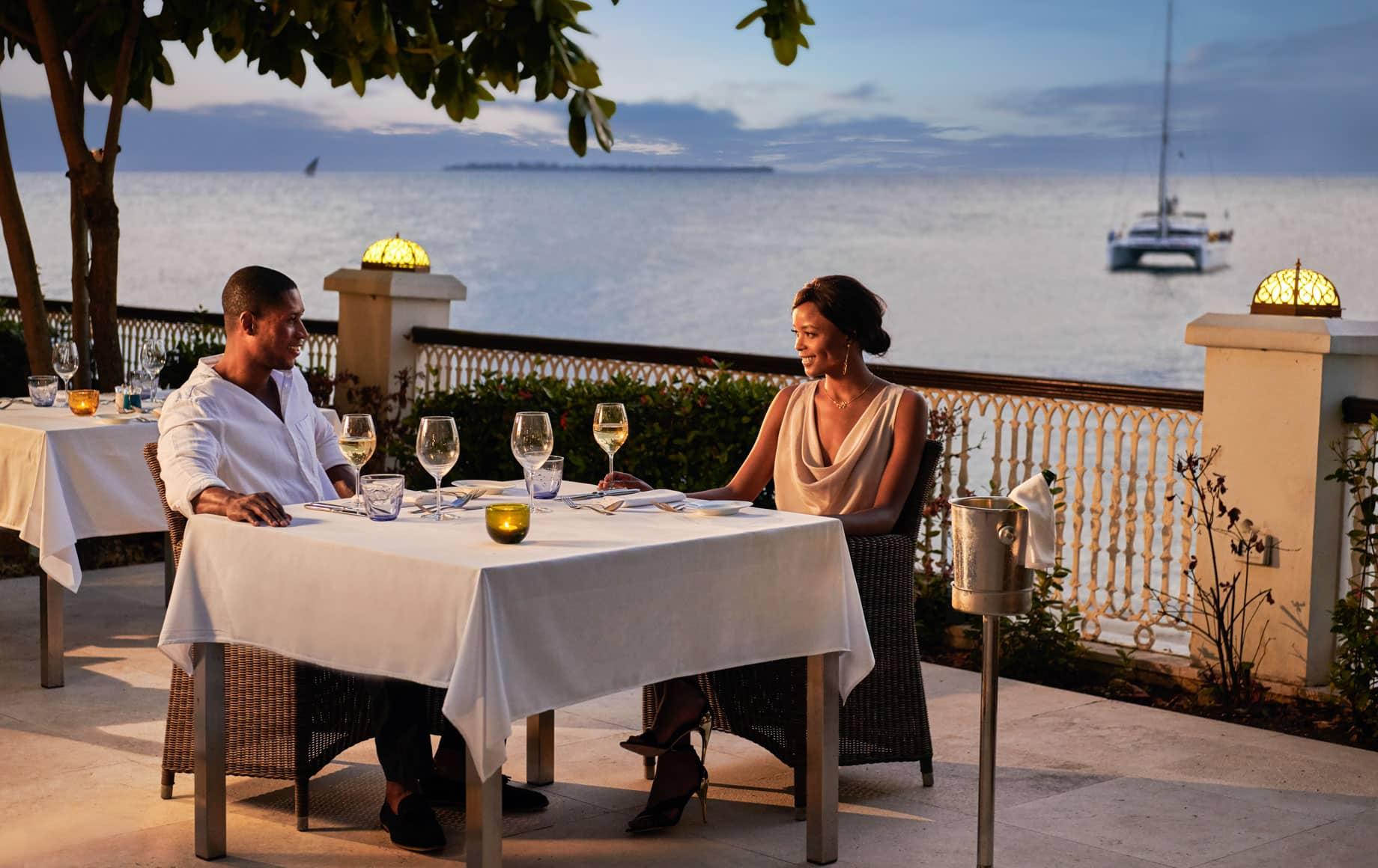 Couple dines outside at Park Hyatt, Zanzibar