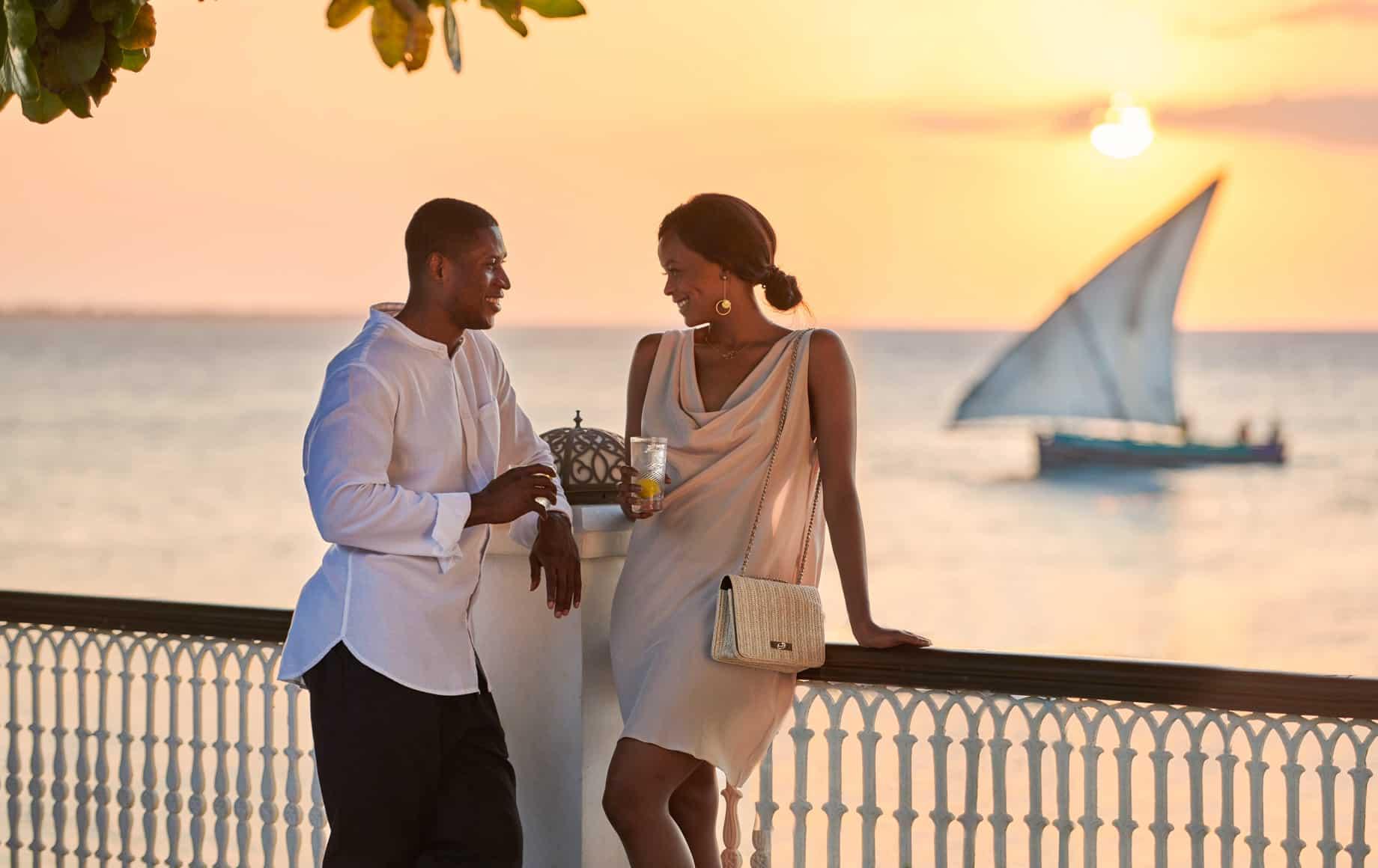 Couple on deck at sunset at Park Hyatt, Zanzibar