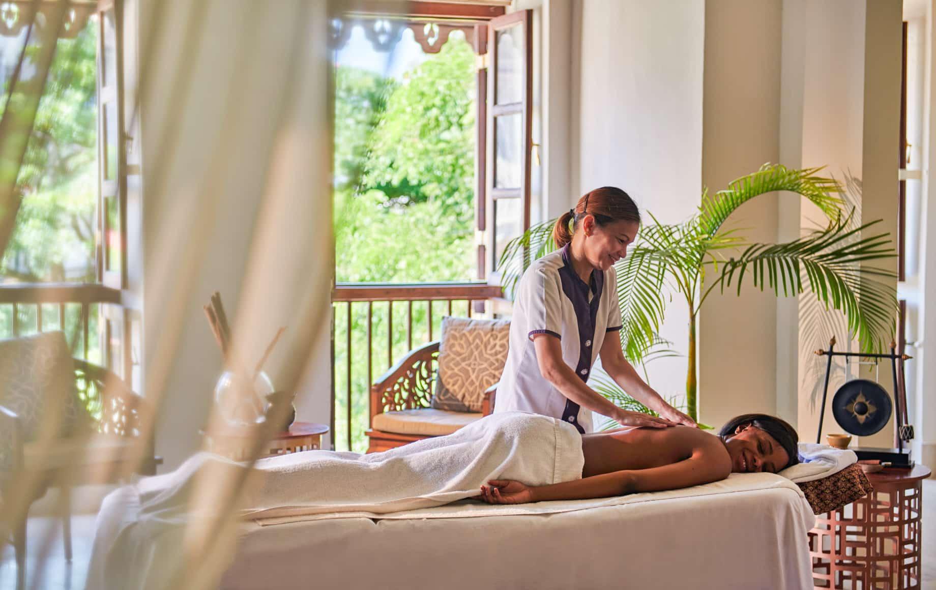 Woman gets massage at Park Hyatt, Zanzibar