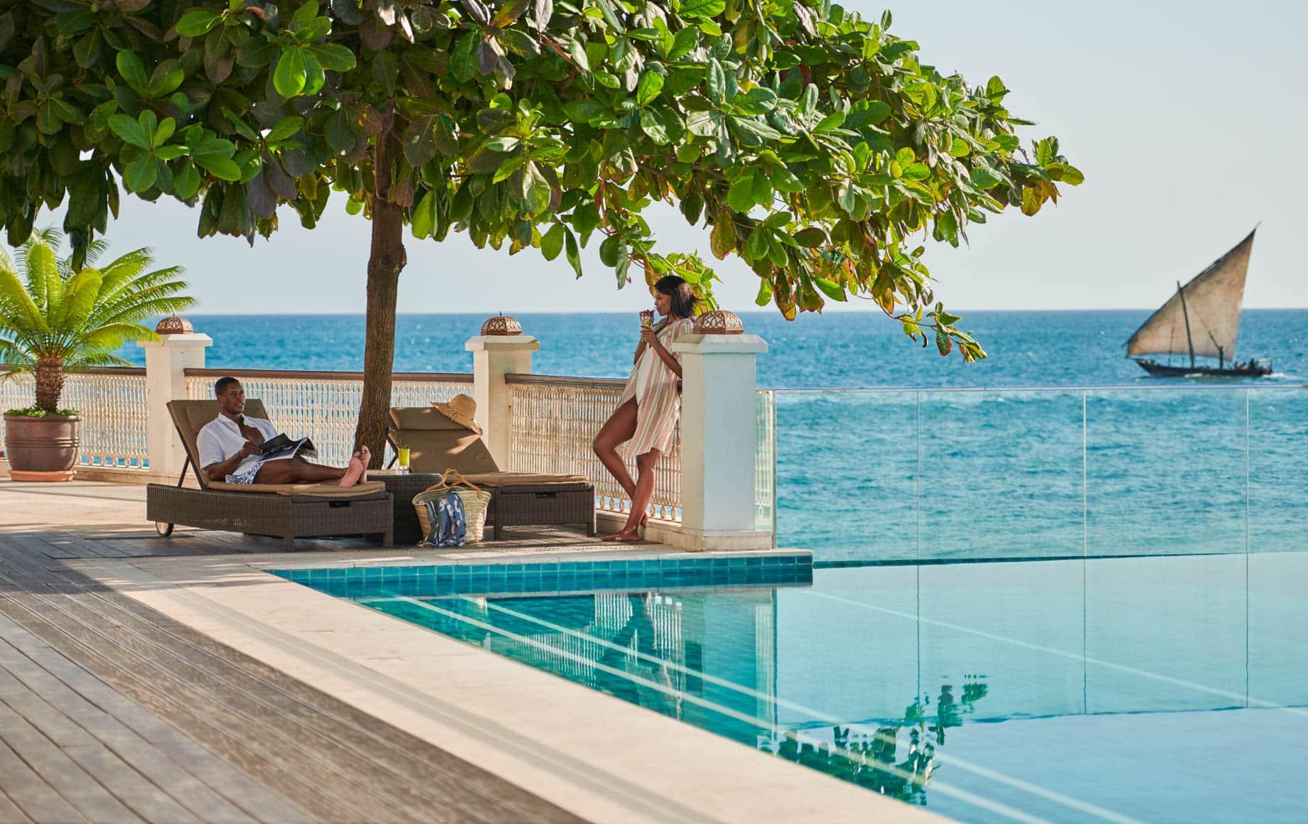 Woman stands near pool at Park Hyatt, Zanzibar