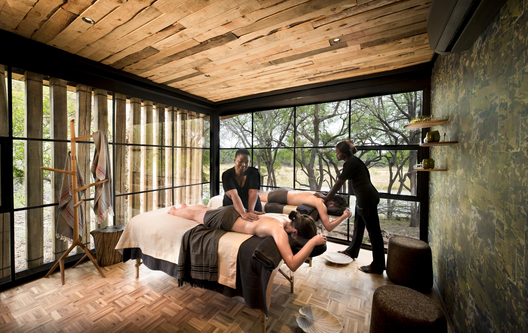 Two travelers get massages at Tengile River Lodge