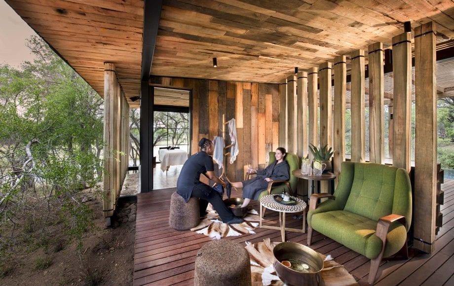 Traveler gets foot massage at Tengile River Lodge