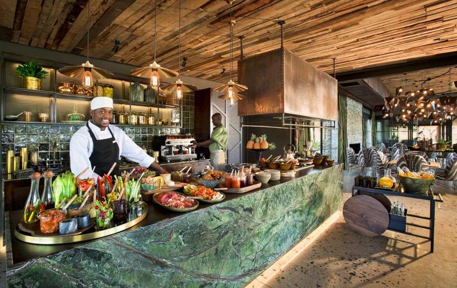 Chef stand behind buffet bar