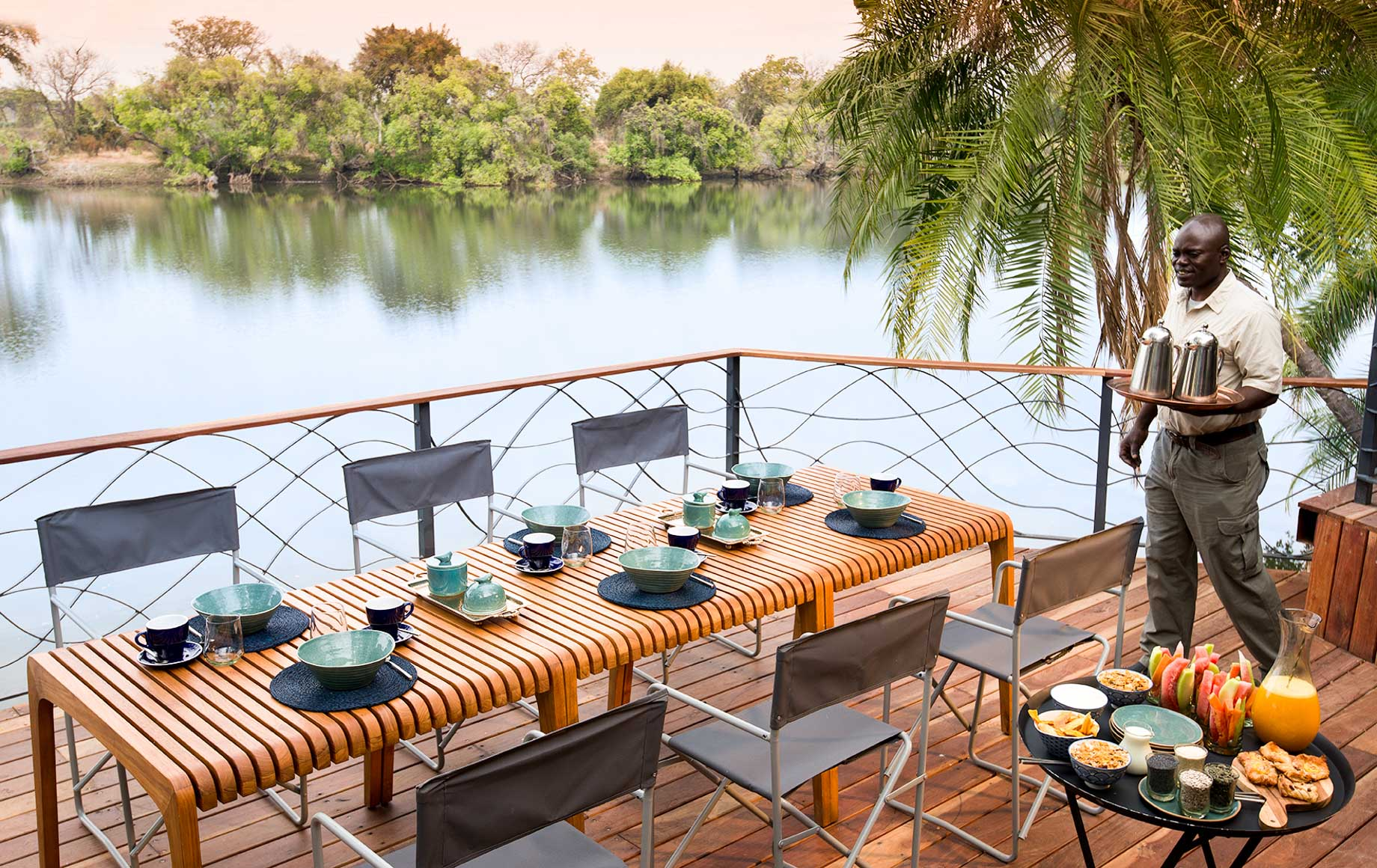 Dinner table on deck of Thorntree River Lodge