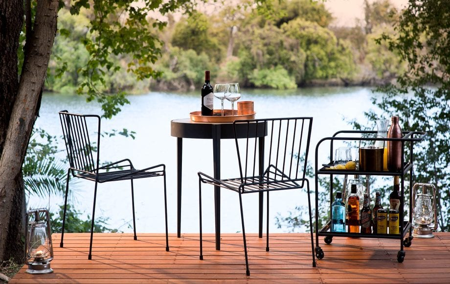 Small table on deck near river