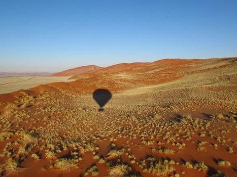 Namib Desert with a shadow of an air balloon