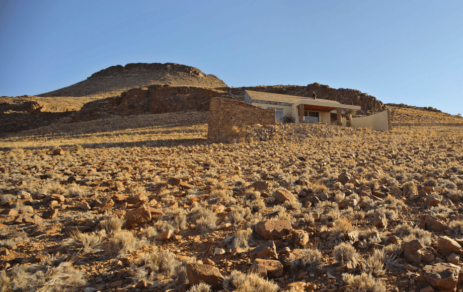 A house in the middle of a desert.