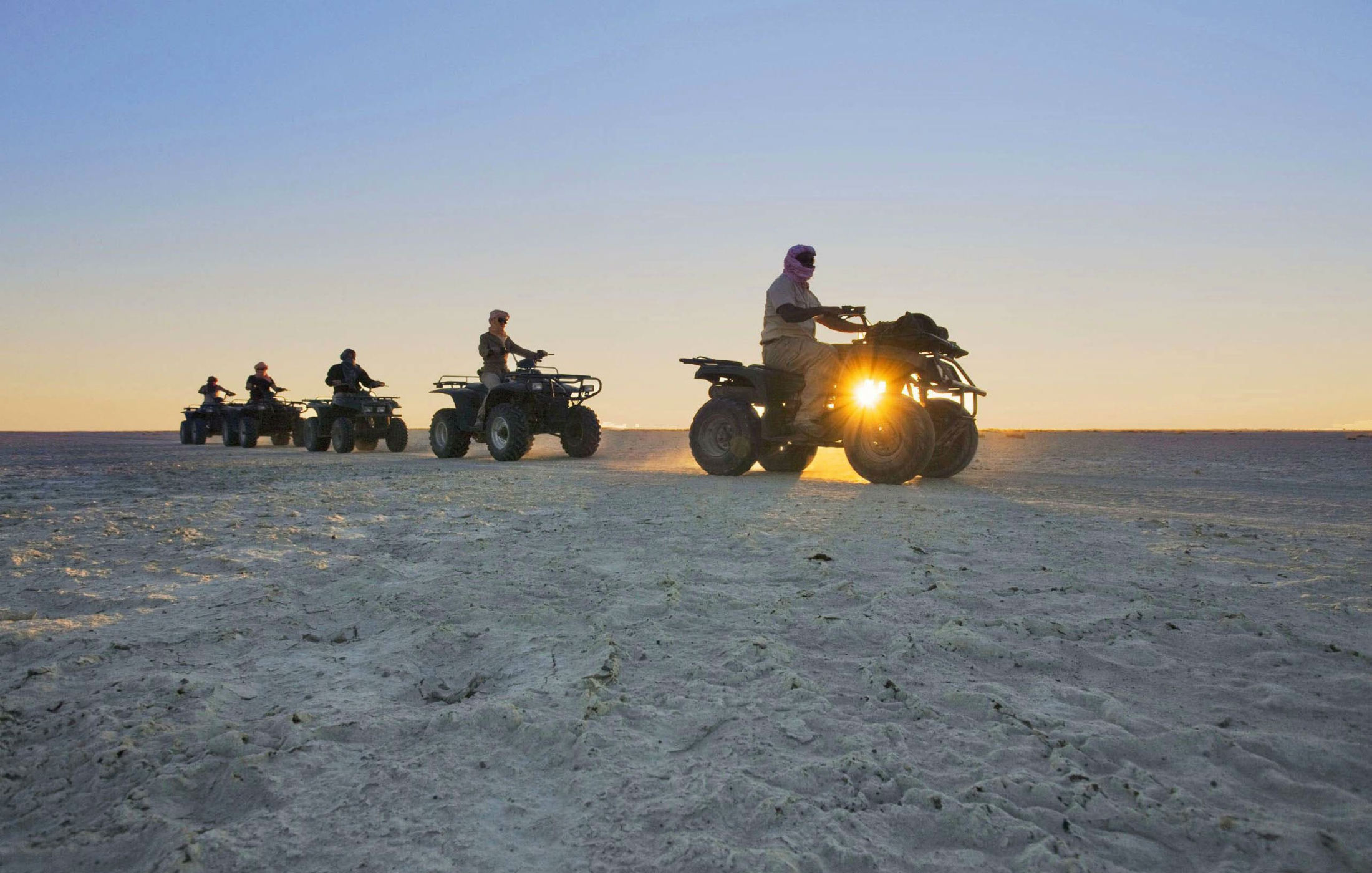 a group of tourists on atvs